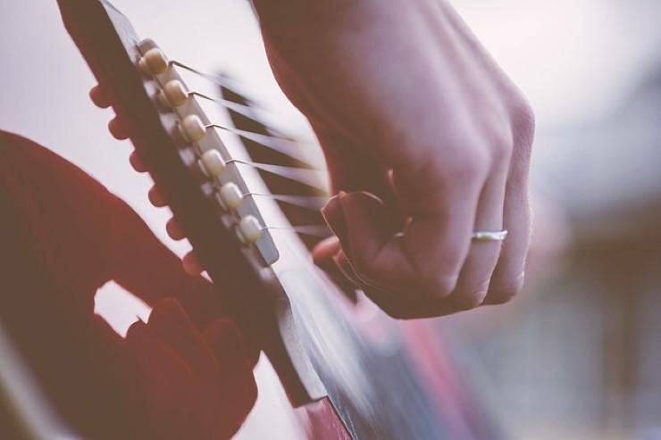 unghie del chitarrista